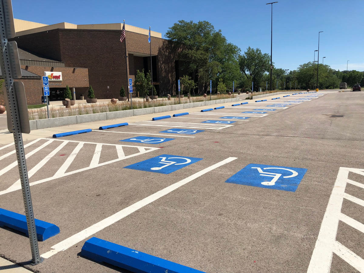 Photo of the west side of the Rapid City Civic Center of the ADA improvements in the parking lot.